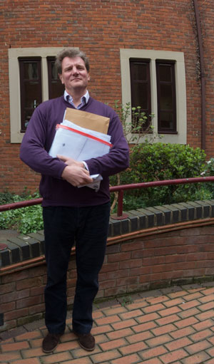 Cllr Mike Murray holding the pile of objections. Photograph 04 April 2014 by B Crowley